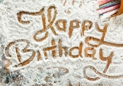 thwall-flour-artwork-with-food-and-handprints-fun-background-with-the-words-happy-birthday-and-human-handpi
